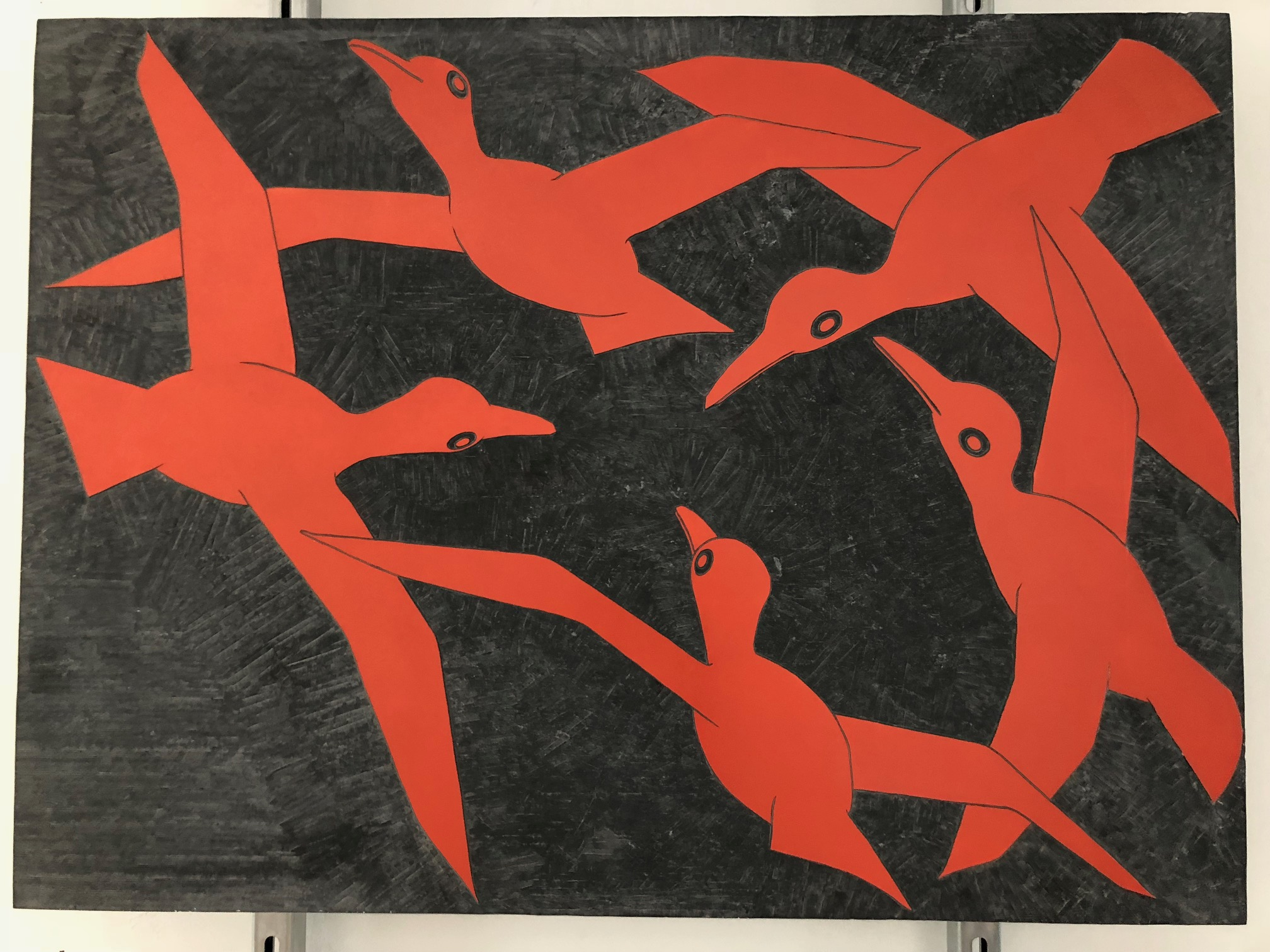Large slate slab carved with four red birds