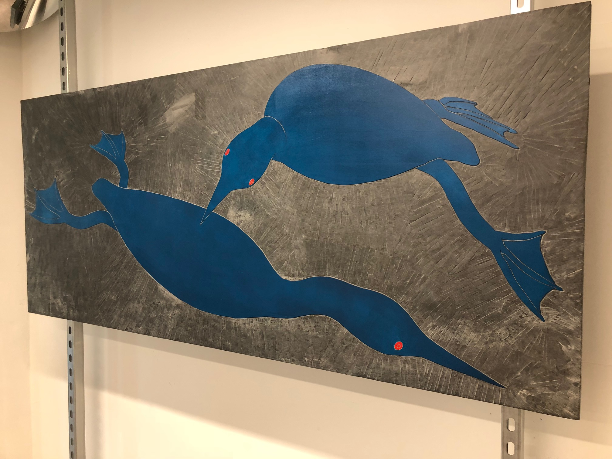 Large slate slab carved with two blue birds