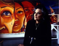 Judy Baca with one of her murals. Image courtesy Judy Baca.