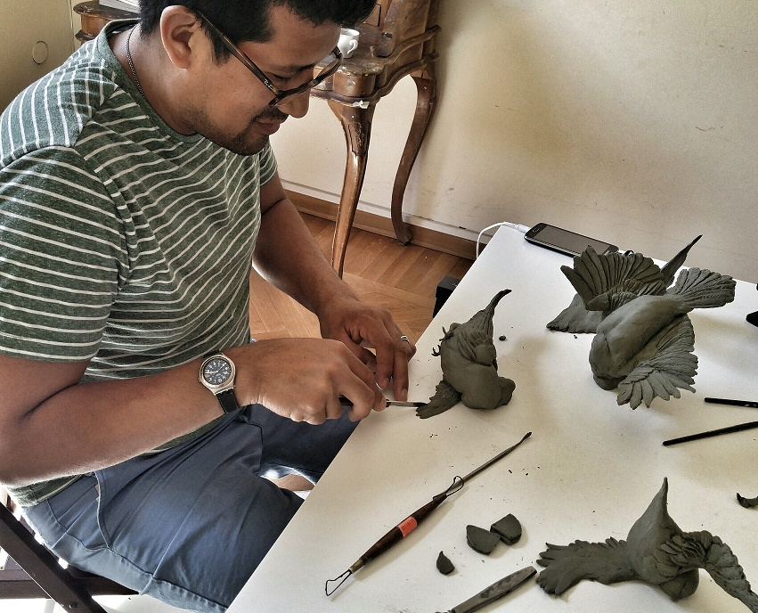 David Salazar working on sculptures of pigeons in the OCAD U studios in Florence (Photo by Jill Price)