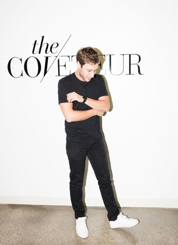 Jake Rosenberg in front of the Coveteur logo