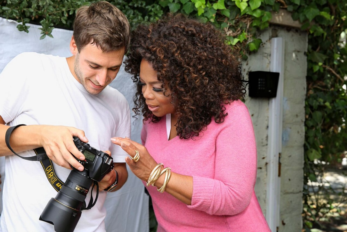 Jake Rosenberg and Oprah Winfrey looking at camera