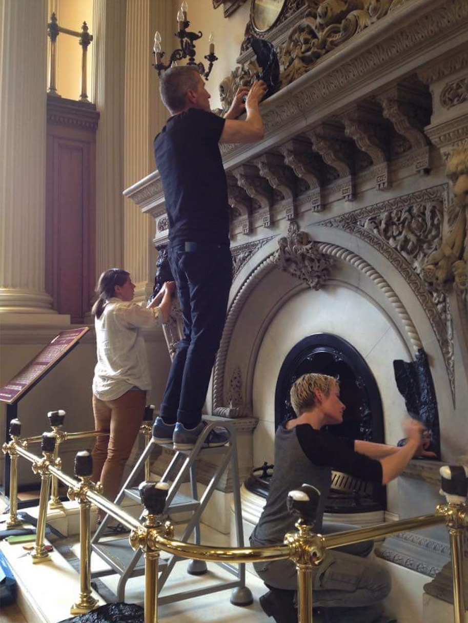 Hadley+Maxwell and artist assistant Alex Achtem casting the iconic fireplace at Osgoode Hall Library