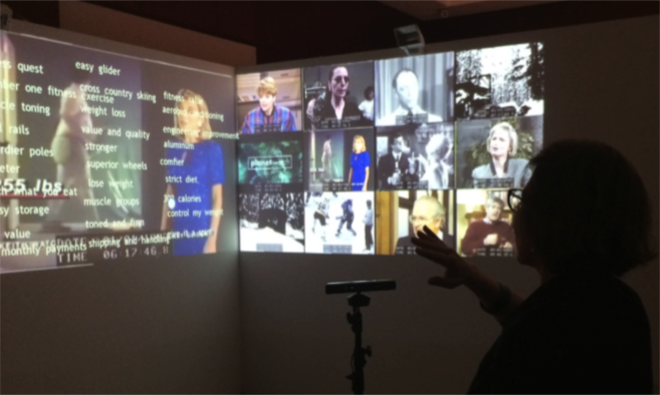 Photograph of CBC Newsworld Holodeck - several news clips from different years displayed concurrently