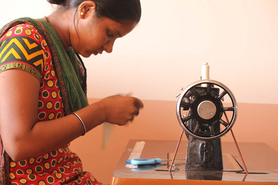 Photograph of woman working at home on CleanCube production
