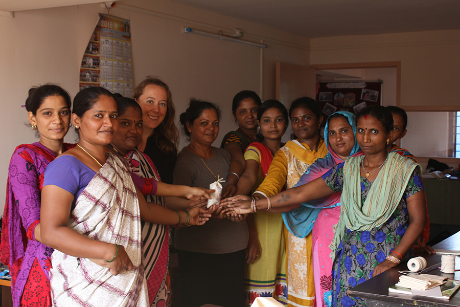 A photograph of group of women who participated in the project, standing together and smiling