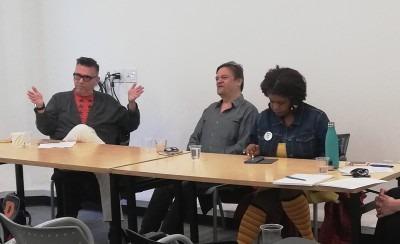 Photo of panelists Ryan Rice, Ashok Mathur and Dori Tunstall speaking.