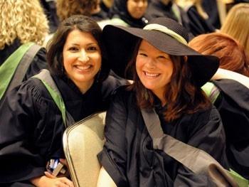 Smiling Graduates at Ceremony