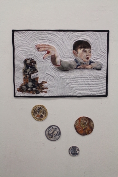 textile artwork with figure