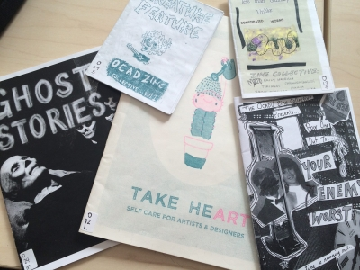 Pictured: a pile of zines made by the OCADU Zine Collective