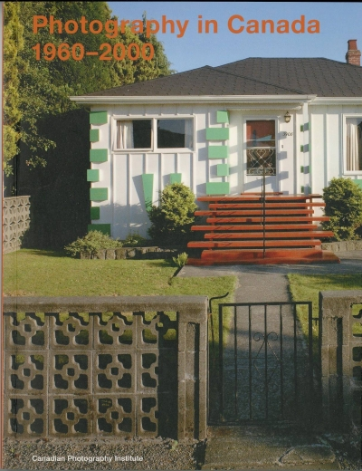 photo of house with green shutters