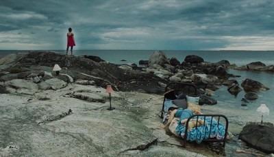 image of women on a rock beach