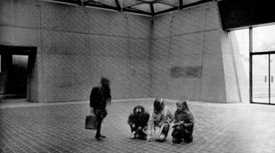 Black and white image of young girls in interior space