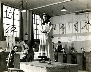 Black and white photograph of an art model posing in a studio