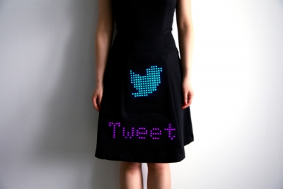 Image of a dress with a digital Twitter bird across the front