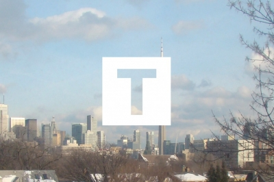 Image of a cityscape with the letter T superimposed
