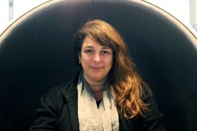 Photo Tania Bruguera, woman with long brown hair, photo by Hugo Huerta Marin