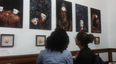 Visitors admiring the artwork on display