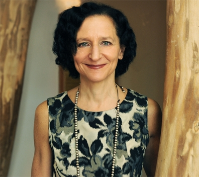 Photograph of President Dr. Sara Diamond in a floral-patterned dress