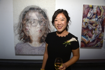 Elizabeth Chan standing in front of a painting