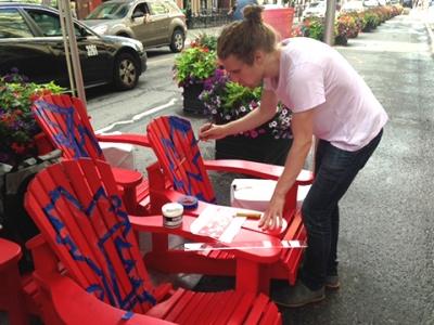 Michael Pitropov paints his chair designs. Photo: Christine Crosbie.