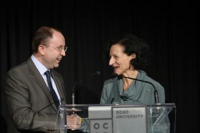 Image of Sara Diamond and Giuseppe Pastorelli at podium
