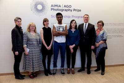 Marvin Luvualu Antonio flanked by Aimia AGO scholarship recipients