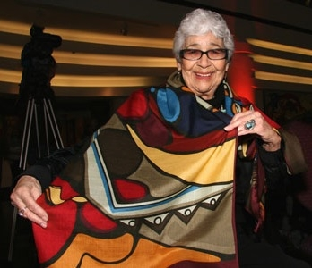 Photo of artist Daphne Odjig with colourful fabric
