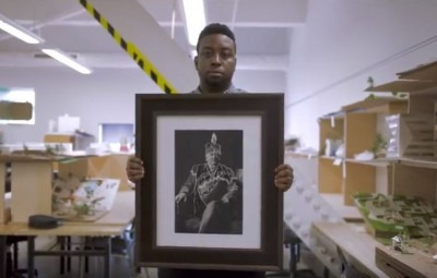 Student holding up a work of art