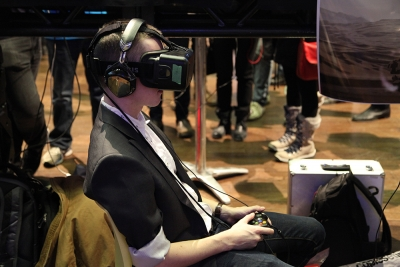 Player using 3-D goggles to play game