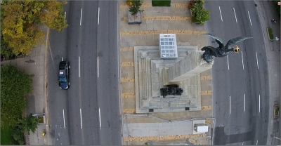 exhibition poster - aerial image of roadway and monument