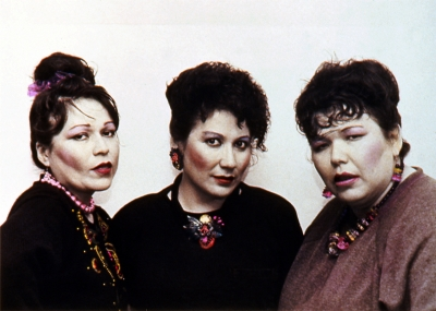 Image of three women with ornate hair and jewelry