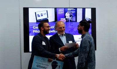 Pitch competition winner, Abid Virani, receives prize cheque from Cassels Brock's Aly Somani. Photo courtesy, Valerie Poon.