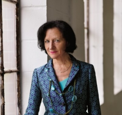 Portrait of Sara Diamond in a blue suit by a window