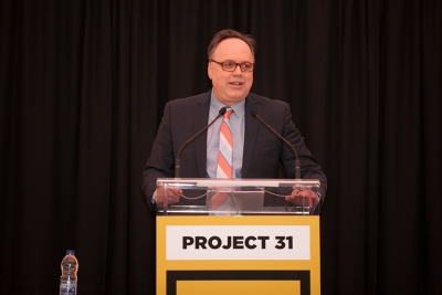 Image of the auctioneer at Project 31