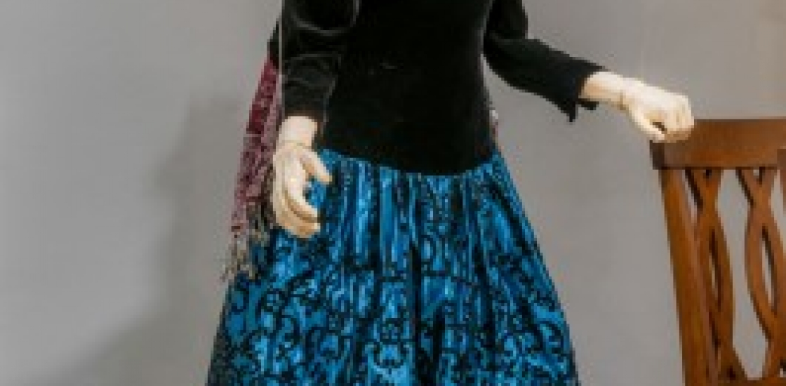 Maniquin in a blue dress and black sweater