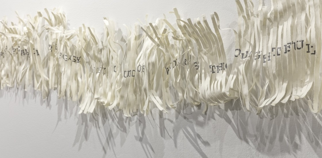 close up of paper based artwork with text