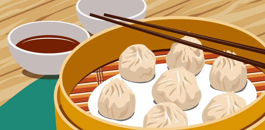 Chinese steamed dumplings with chopsticks
