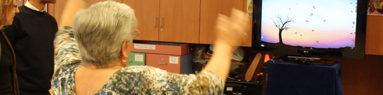 Person waving their arms interacting with the work