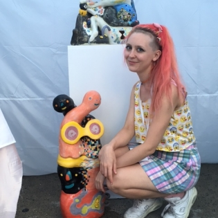 Artist Kaley Bowers with ceramic sculptures