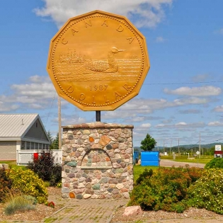 """Image of a monument to the """"loonie"""" one dollar coin"""