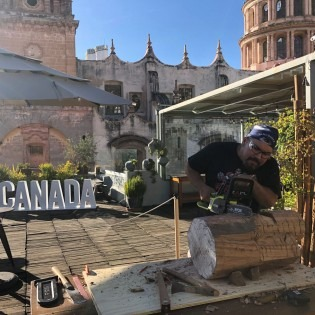 Artist Luke Parnell working at rooftop studio, Guanajuato, Mexico
