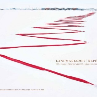 White book cover with red zig-zag of textile on snow