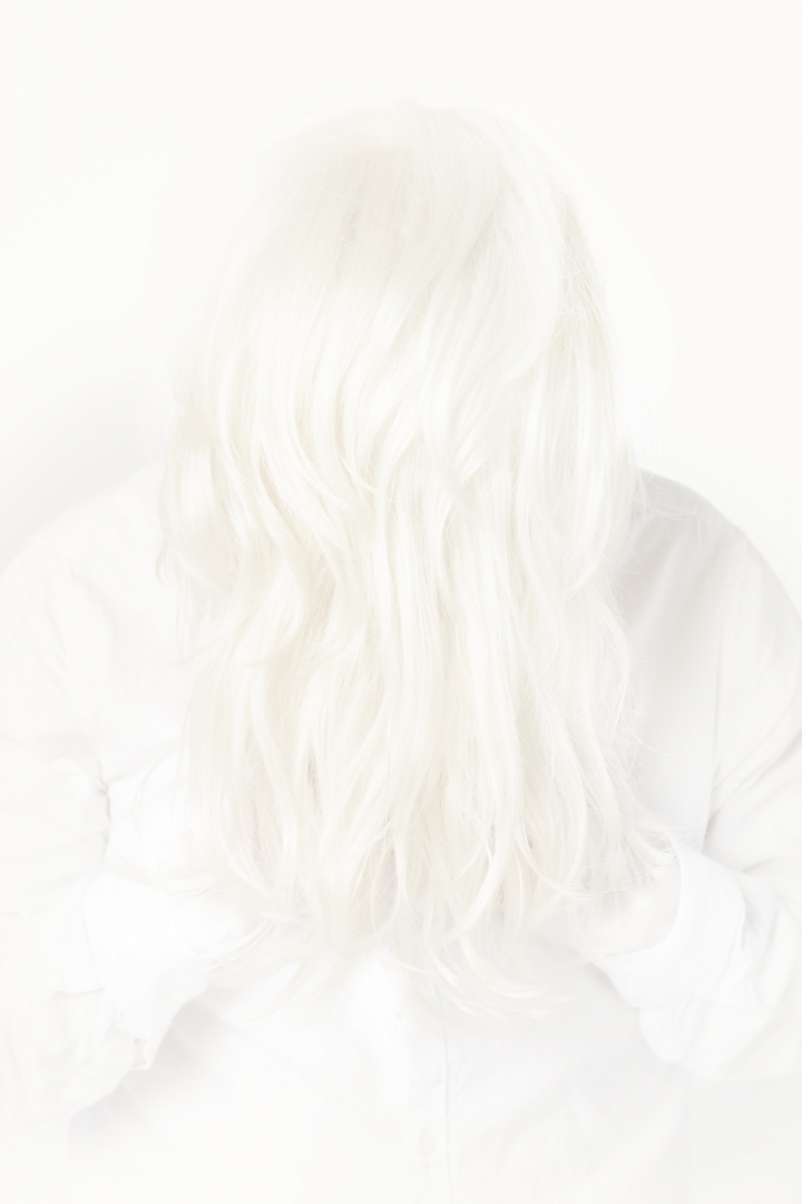 photo of a person with blond hair covering face