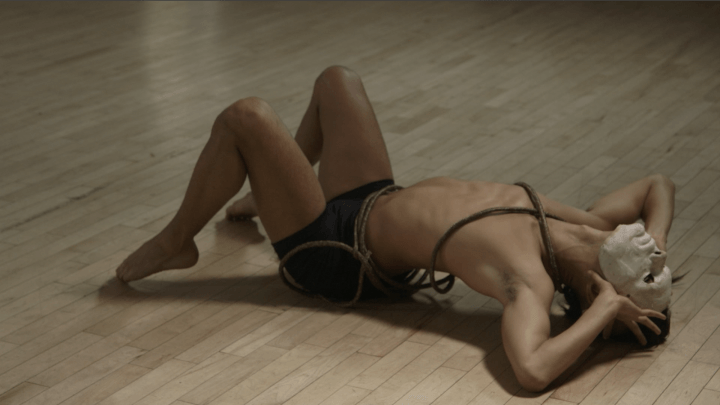 photo of male dance in pose on the floor