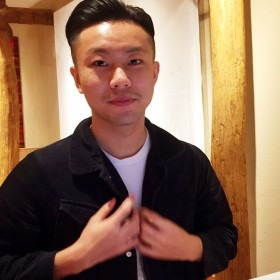 Headshot of Peiheng Zhao wearing a black jacket and white shirt.
