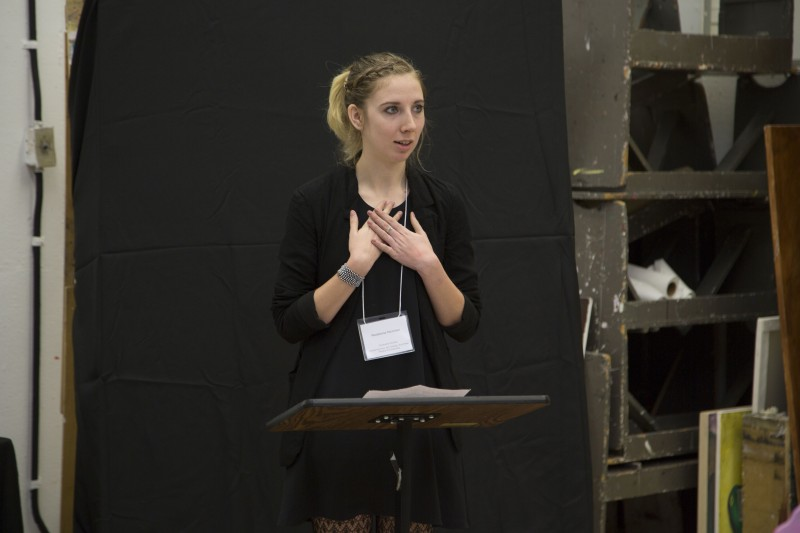 Student Madeleine McMillan speaking at lectern