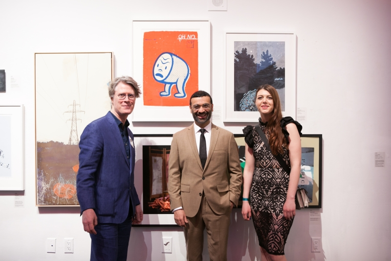 Stuart Reid, Gary Taxali and Jessica Rysyk standing in front of work.
