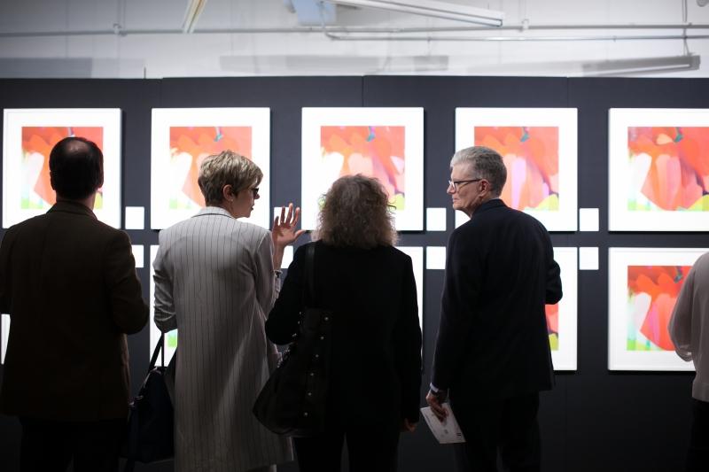 Guests looking at a series of digital paintings