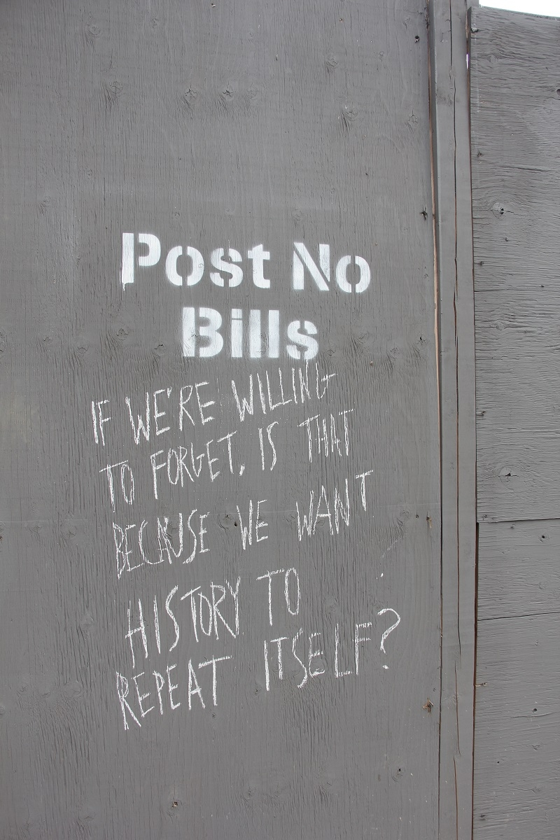 construction hoarding with 'post no bills' warning
